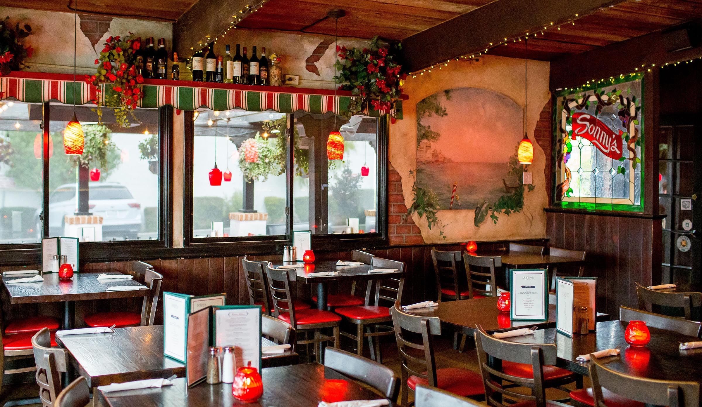 Inside Sonny's. Warm and inviting. Classic rustic Italian decor with twinkle lights and candles.